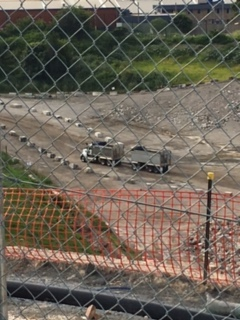 Open truck leaves asbestos stockpile at Alexandria Landfill. No hoses visible