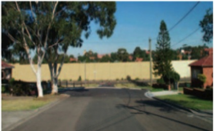 The noise wall is visually divisive and bears no contextual relationship to the setting in this residential area on the Northern side of the M5 East